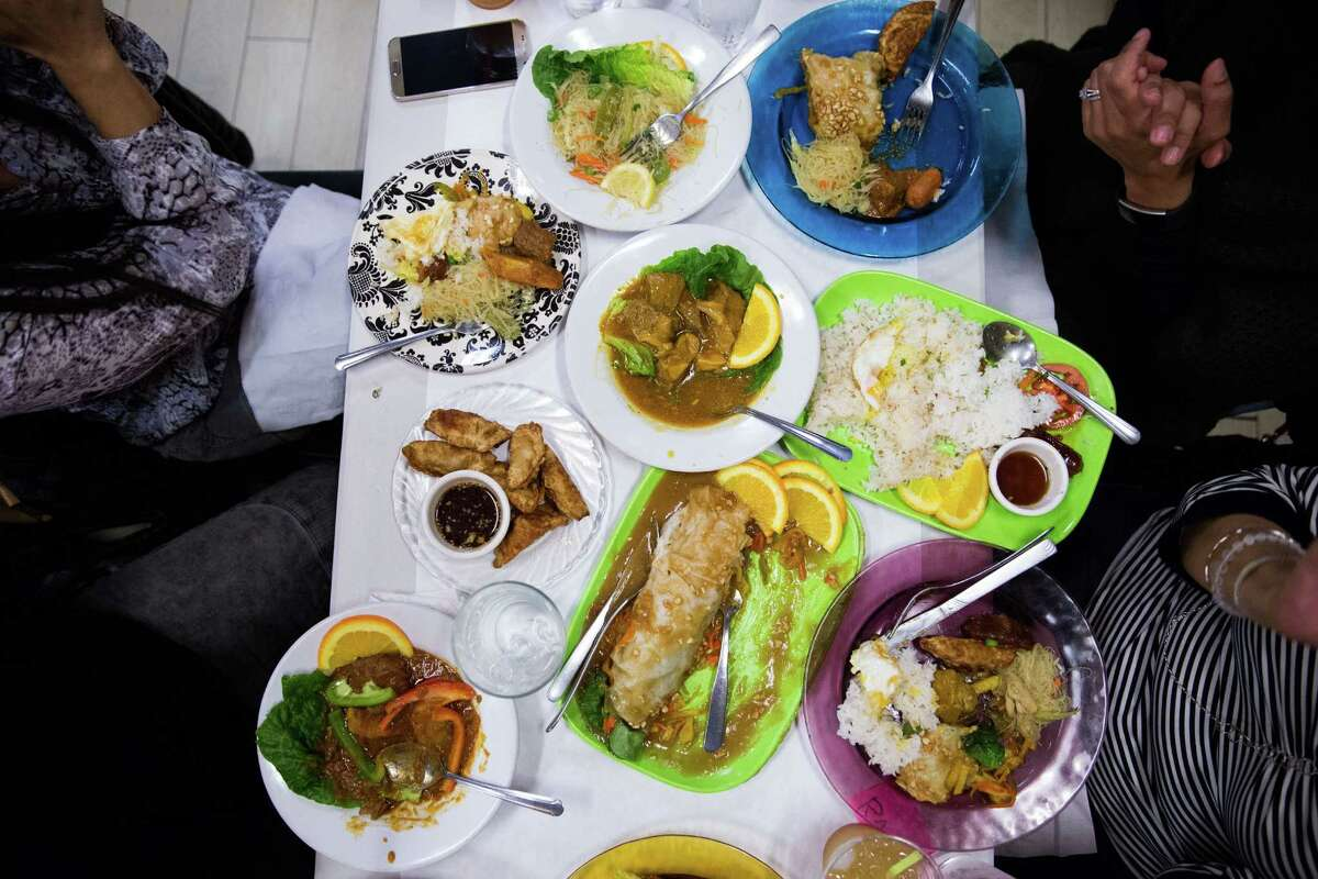 A group of women enjoy Filipino home-style cooking.