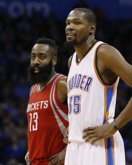 Houston Rockets guard James Harden (13) and Oklahoma City Thunder forward Kevin Durant (35) talk during the second quarter of an NBA basketball game in Oklahoma City, Friday, Jan. 29, 2016. Oklahoma City won 116-108. (AP Photo/Sue Ogrocki) Photo: Associated Press