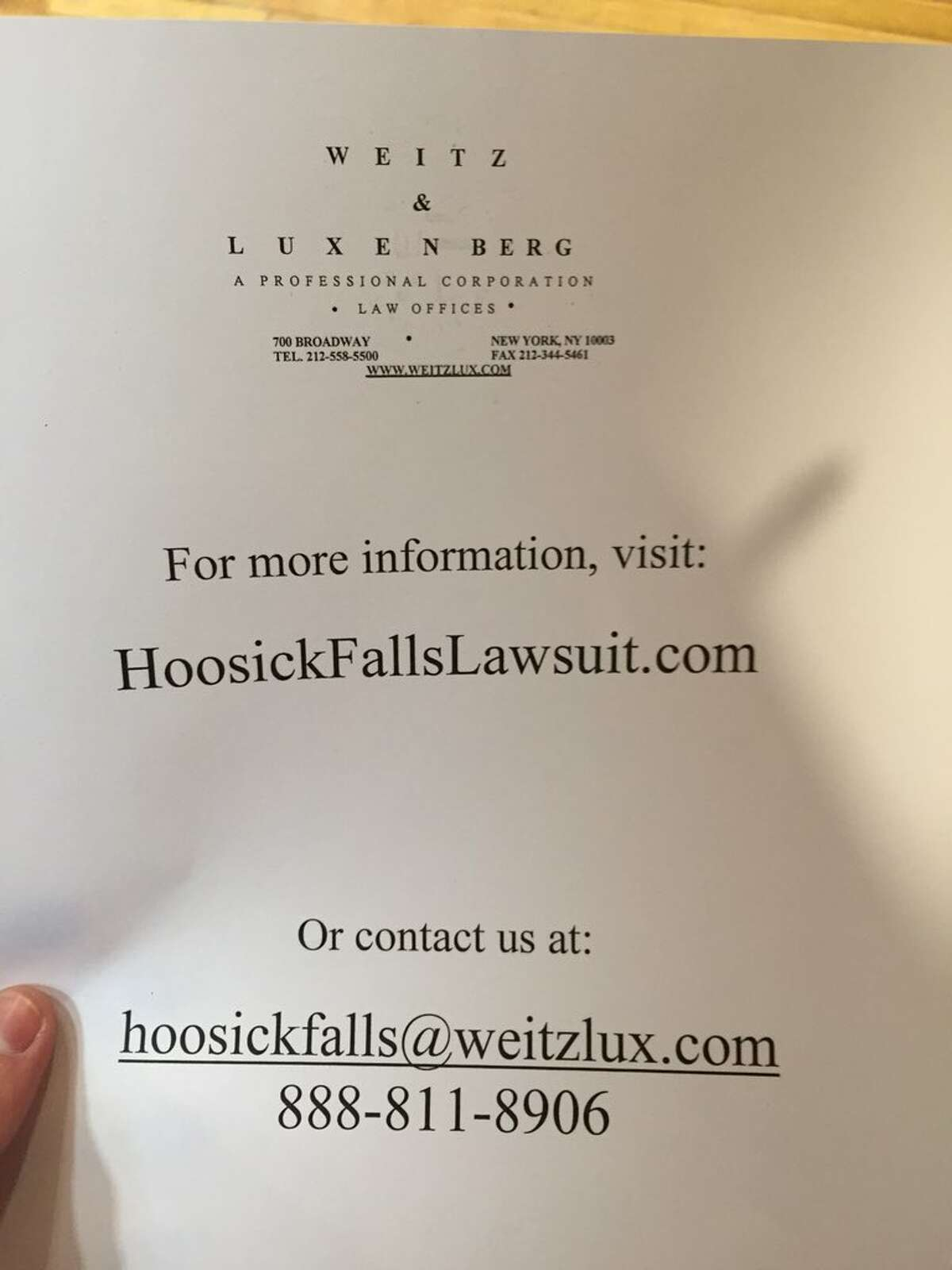 A flyer that was distributed on Saturday, Jan. 30, 2016, by the law firm Weitz & Luxenberg to those attending a community meeting at Bennington College to address water contamination in nearby Hoosick Falls. The law firm brought Erin Brockovich to meet with residents. (Matthew Hamilton/Times Union)