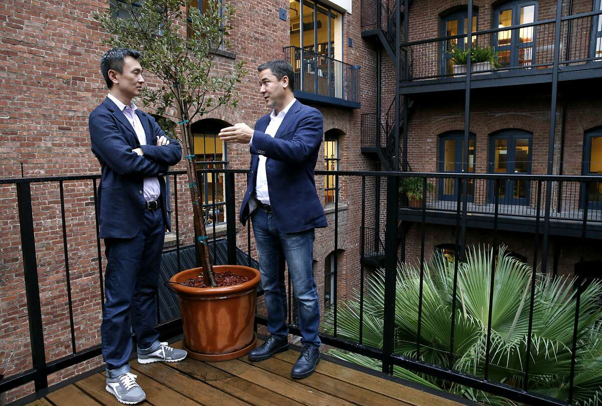 Tien Tzuo, CEO and co-founder, meets with Zuora's president Marc Diouane, on the outdoor deck of the subscription billing company's offices on Sansome Street in San Francisco, Calif. on Friday, Jan. 29, 2016.