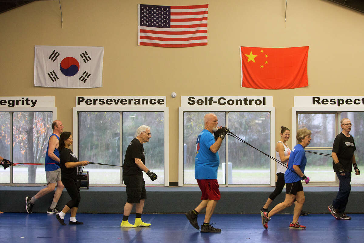 Participants workout during a boxing class for people with Parkinson's disease at Battenberg's Blackbelt Academy, Inc, Thursday, Jan. 21, 2016, in Kingwood.