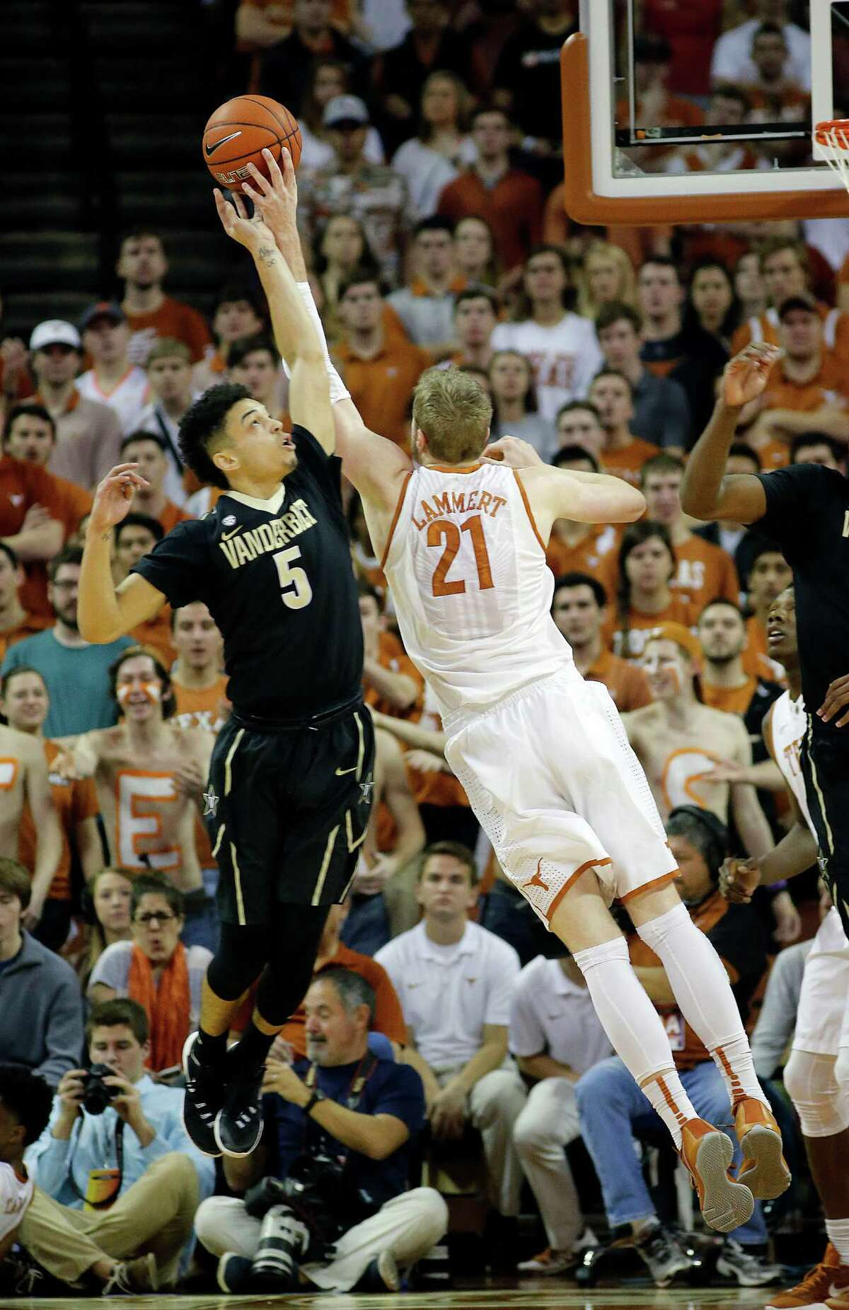 AUSTIN, TX - JANUARY 30: Matthew Fisher-Davis #5 of the Vanderbilt Commodores and Connor Lammert #21 of the Texas Longhorns battles for rebound at the Frank Erwin Center on January 30, 2016 in Austin, Texas.