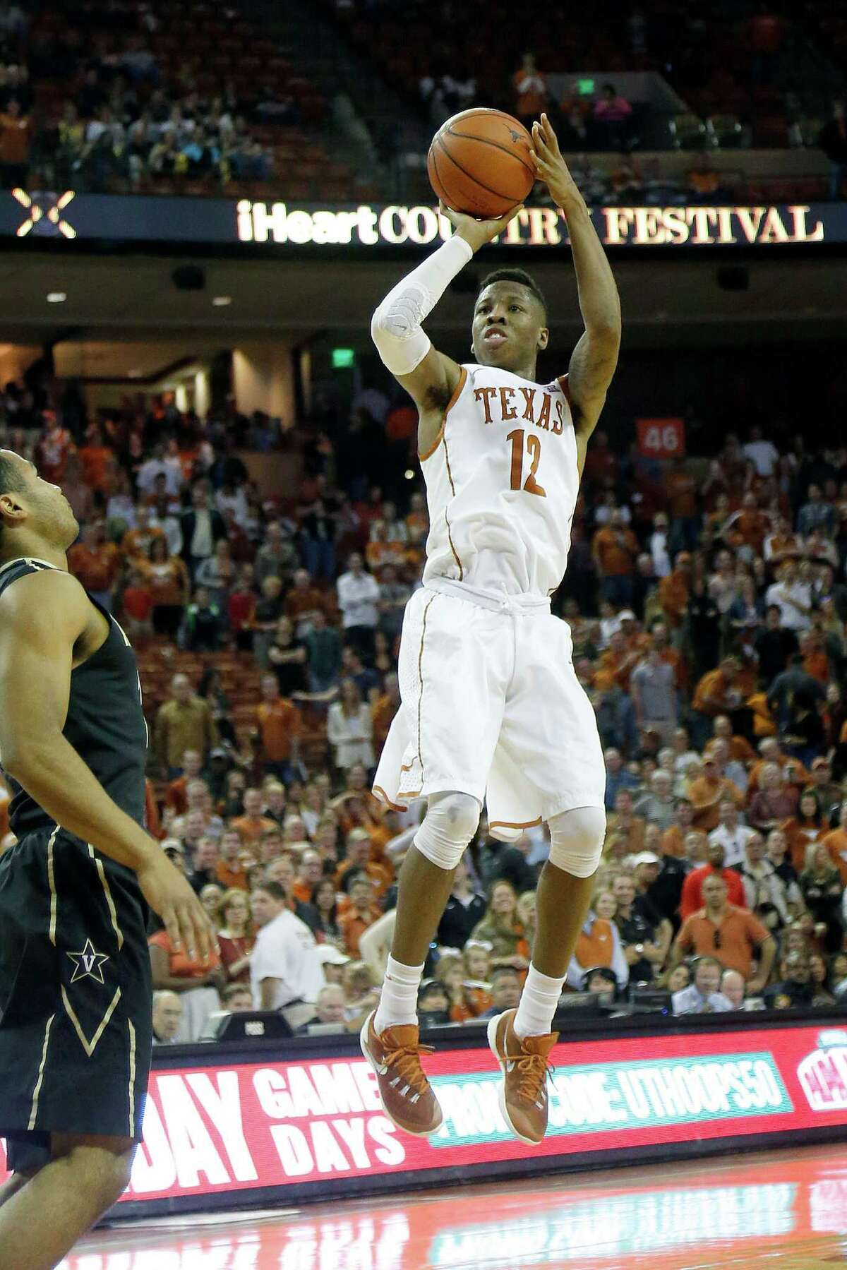 AUSTIN, TX - JANUARY 30: Kerwin Roach Jr. #12 of the Texas Longhorns shoots the ball against the Vanderbilt Commodores at the Frank Erwin Center on January 30, 2016 in Austin, Texas.