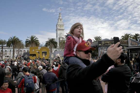 Clay Marquez and his daughter Penny, 3 of San Francisco take in the sites during the opening of the free fan experience Super Bowl City at the foot of Market St. in downtown San Francisco, Calif., on Sat. January 30, 2016, in celebration of Super Bowl 50.