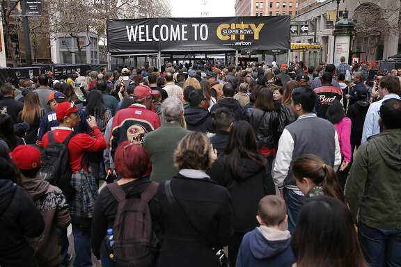Fans fill the West entrance into the security check point during the opening of the free fan experience Super Bowl City at the foot of Market St. in downtown San Francisco, Calif., on Sat. January 30, 2016, in celebration of Super Bowl 50.