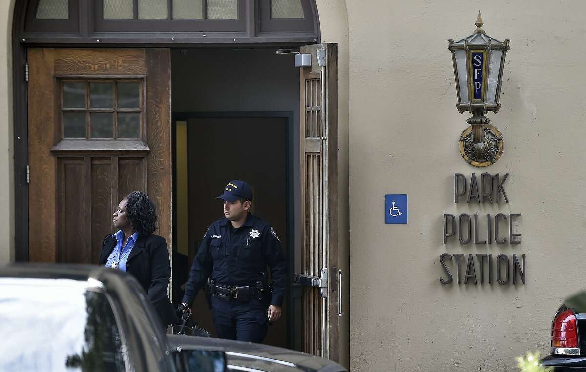 Police officers exit a police station after SFPD caught up with two fugitives near a McDonald's restaurant at the corner of Haight and Stanyan and arrested them in San Francisco on Jan. 30, 2016. The two men escaped from an Orange County prison and fled before being caught.