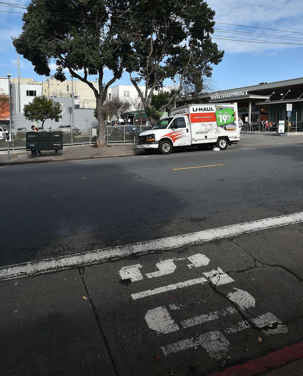 An empty parking space is seen (L) where a stolen van containing two fugitives was parked near a Whole Foods store at the corner of Haight and Stanyan in San Francisco on Jan. 30, 2016. The two men escaped from an Orange County prison and fled before being arrested in San Francisco.