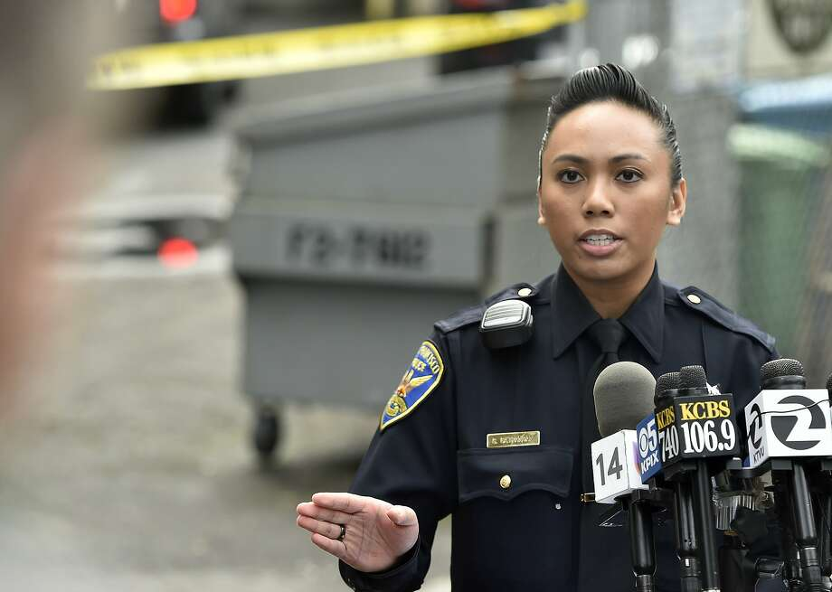 Officer Grace Gatpandan describes how SFPD caught and arrested two fugitives near a McDonald's restaurant at the corner of Haight and Stanyan in San Francisco on Jan. 30, 2016. The two men escaped from an Orange County prison and fled before being caught in San Francisco. Photo: Josh Edelson, JOSH EDELSON / SAN FRANCISCO CHR