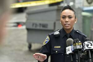 Officer Grace Gatpandan describes how SFPD caught and arrested two fugitives near a McDonald's restaurant at the corner of Haight and Stanyan in San Francisco on Jan. 30, 2016. The two men escaped from an Orange County prison and fled before being caught in San Francisco.