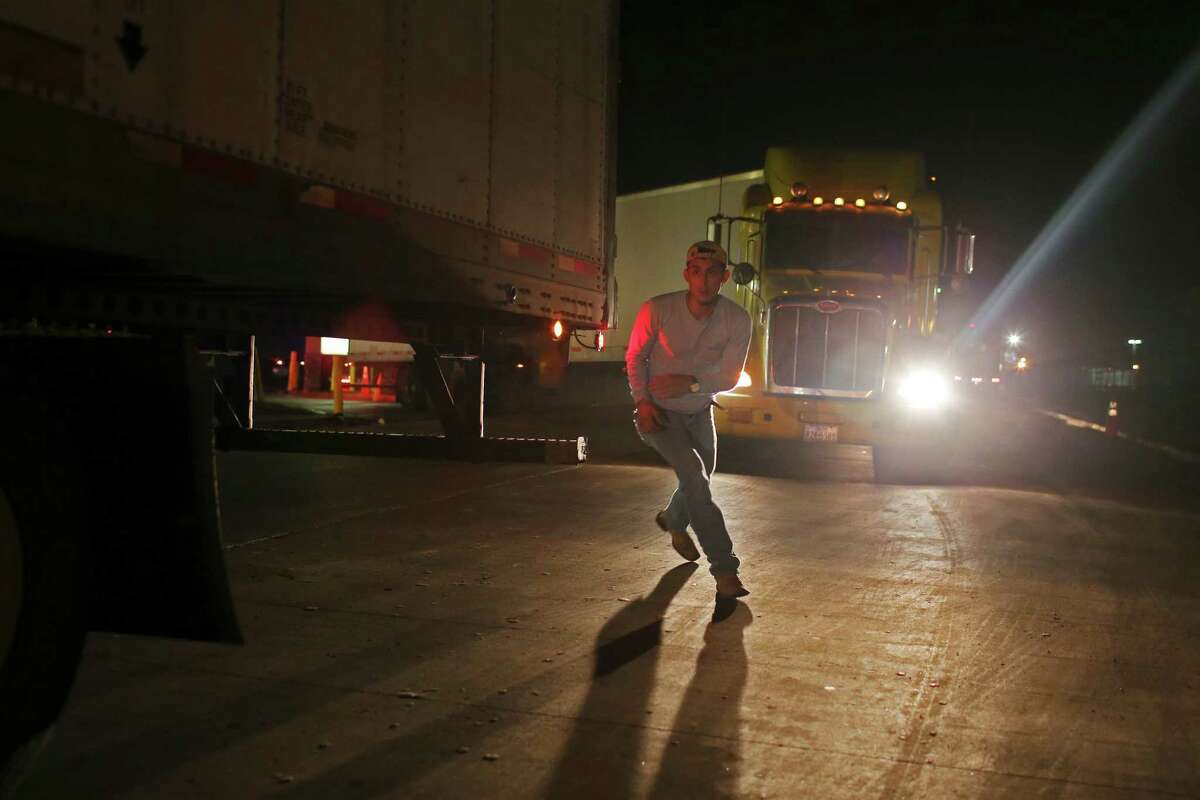 After securing his load of produce, a trucker rushes to the cab as other trucks wait to load along a street in a cold storage warehousing area near the Pharr-Reynosa International Bridge, Tuesday, Jan. 19, 2016. With new infrastructure built in Mexico, growers from that country have seen that it is less expensive to ship their produce through Texas, especially, Pharr, to reach markets in the Northern states. The Pharr port is on trend to surpass Nogales, Arizona as the single largest entry point for imports of Mexican fresh produce.