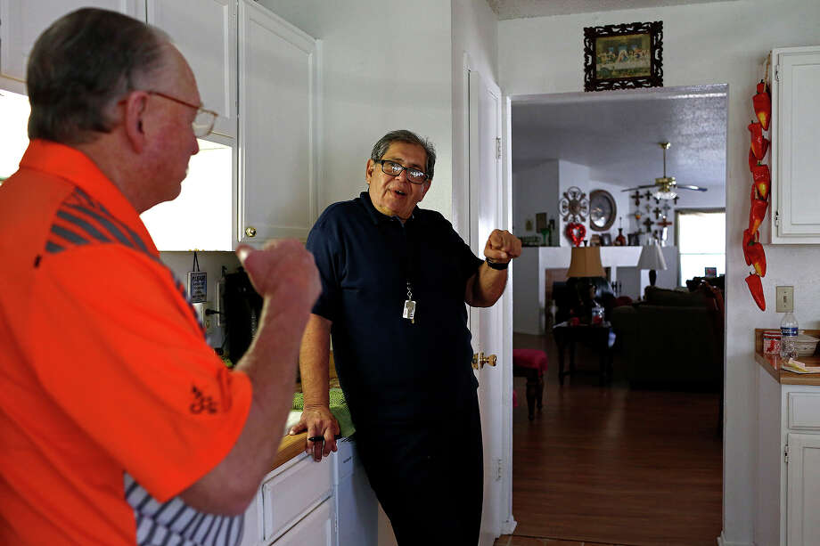 Robert Gill talks with his brother-in-law, Andy Walker, left,  at Walker's home in San Antonio on Friday, Jan. 29, 2016. Gill is a nonviolent drug offender who spent 25 years in prison until last summer, when President Obama commuted his life sentence. Photo: Lisa Krantz, San Antonio Express-News / San Antonio Express-News / ©2015 San Antonio Express-News