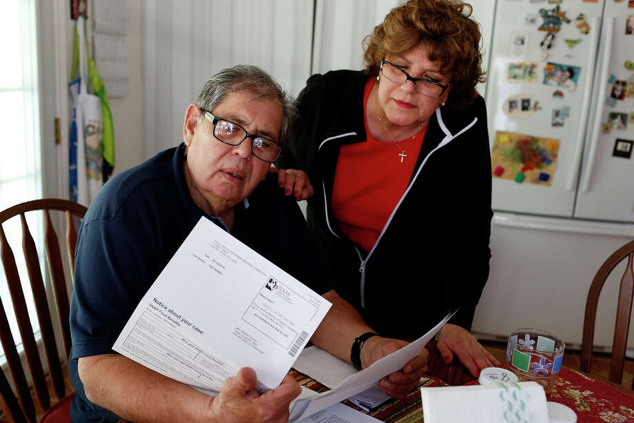 Robert Gill, with his sister, Yolanda Gill-Walker, looks at a letter indicating his SNAP benefits are being reduced at his sister's home in San Antonio on Friday, Jan. 29, 2016. His sister and her husband have been two of his biggest supporters during his reentry process. Gill is a nonviolent drug offender who spent 25 years in prison until last summer, when President Obama commuted his life sentence. Photo: Lisa Krantz, San Antonio Express-News / San Antonio Express-News / ©2015 San Antonio Express-News