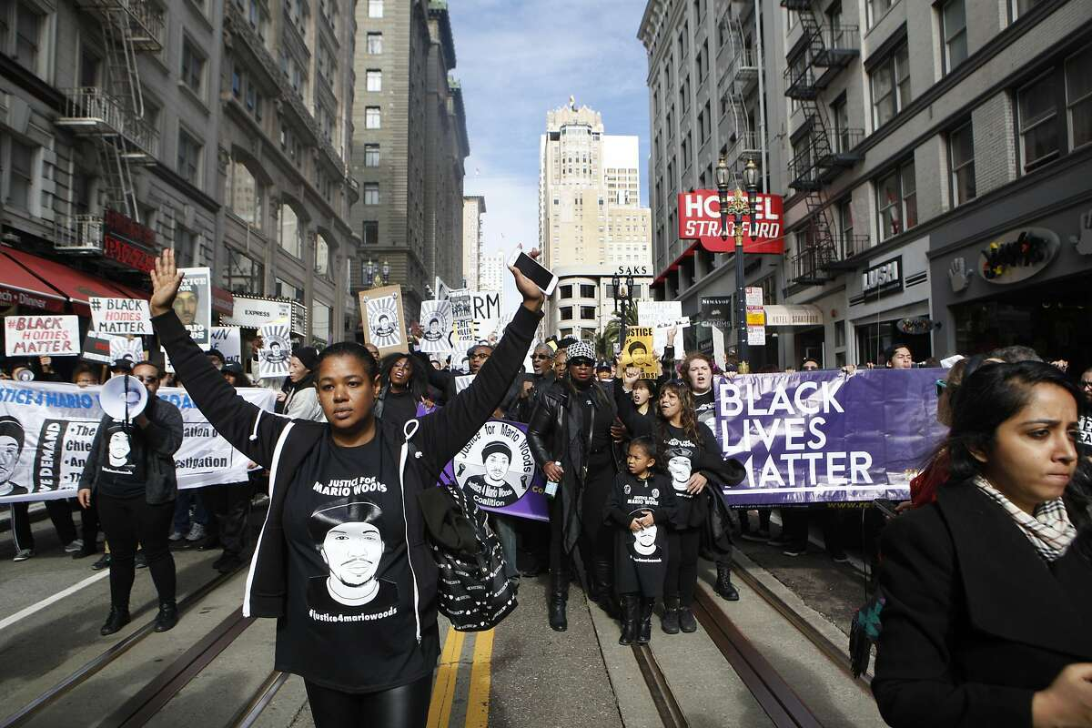 Yayne Abeba (left) leads protesters demanding justice for Mario Woods, the Bayview man shot and killed by police nearly two months ago, on a march down Powell Street from Union Square to the site of Super Bowl City in San Francisco, Calif. on Saturday, Jan. 30, 2016.