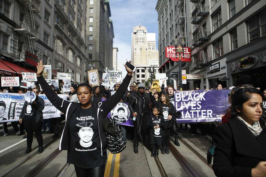 Yayne Abeba (left) leads protesters demanding justice for Mario Woods, the Bayview man shot and killed by police nearly two months ago, on a march down Powell Street from Union Square to the site of Super Bowl City in San Francisco, Calif. on Saturday, Jan. 30, 2016. Photo: Brittany Murphy, The Chronicle