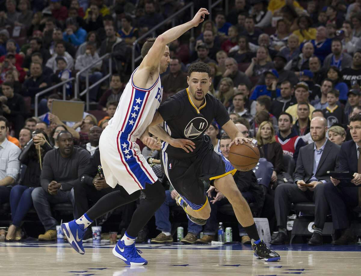 PHILADELPHIA, PA - JANUARY 30: Klay Thompson #11 of the Golden State Warriors drives past Nik Stauskas #11 of the Philadelphia 76ers on January 30, 2016 at the Wells Fargo Center in Philadelphia, Pennsylvania. NOTE TO USER: User expressly acknowledges and agrees that, by downloading and or using this photograph, User is consenting to the terms and conditions of the Getty Images License Agreement. (Photo by Mitchell Leff/Getty Images)