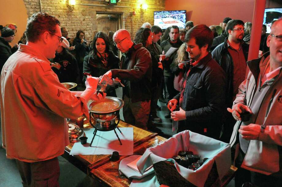 Mexican Radio owner Mark Young, left, ladles out red posole with shredded pork soup during the Schenectady Soup Stroll on Saturday Jan. 30, 2016 in Schenectady, N.Y.  (Michael P. Farrell/Times Union) Photo: Michael P. Farrell / 10035222A