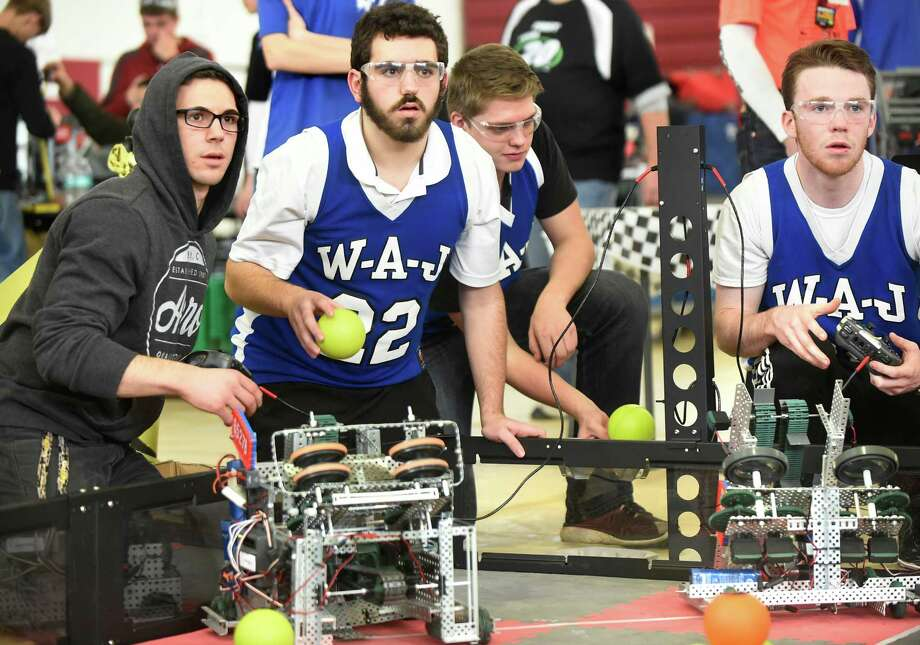 A robotics team from Windham Ashland Jewitt Central competes in the quarterfinals during the Bots Take Burgh VEX Robotics Competition on Saturday, Jan. 30, 2016, at Lansingburgh High in Troy, N.Y. From left are Anthony Savasta, 17, Dante Savasta, 15, David Skopinsky, 18, and Aidan Cohane, 17. Over 40 Teams competed against each other with robots created from VEX EDR. They played a game called Nothing But Net where they fired colored balls into high and low goals and elevated robots in a designated climbing zone. (Cindy Schultz / Times Union) Photo: Cindy Schultz / Albany Times Union