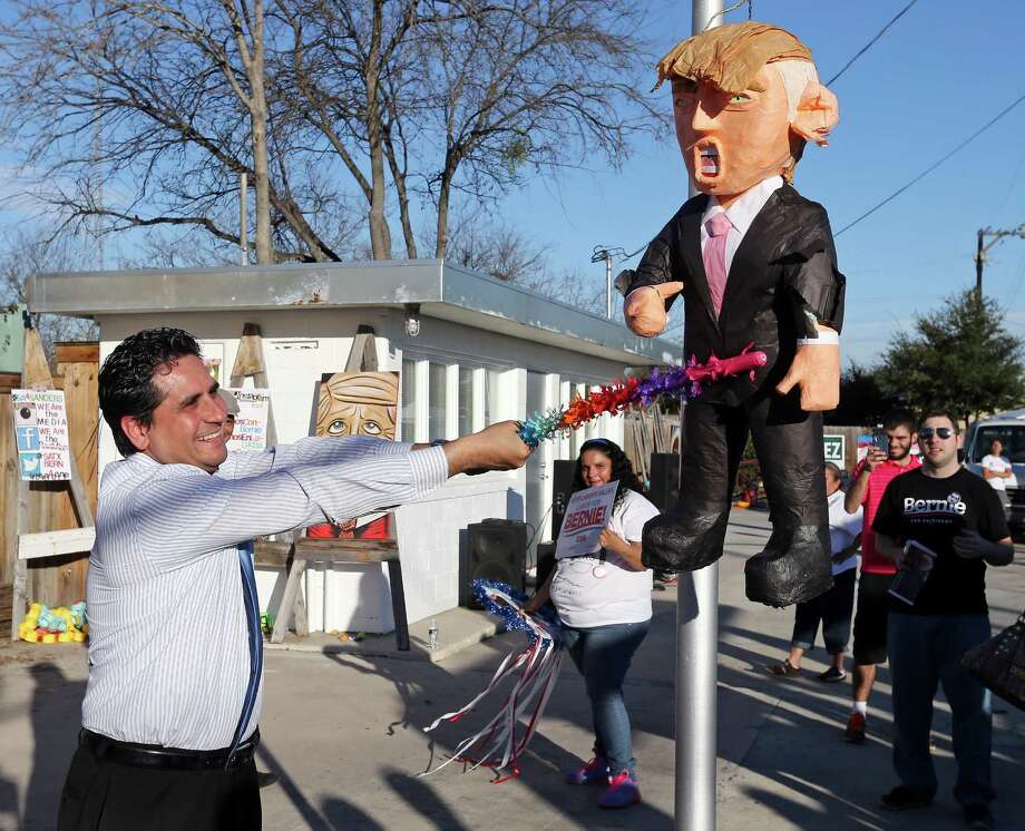"Bexar County Democratic Party Chairman Manuel Medina hits a Donald Trump pinata during the ÒBernie Beats Trump on the West Side"" event held Saturday Jan. 30, 2016. Photo: Edward A. Ornelas, Staff / San Antonio Express-News / © 2016 San Antonio Express-News"