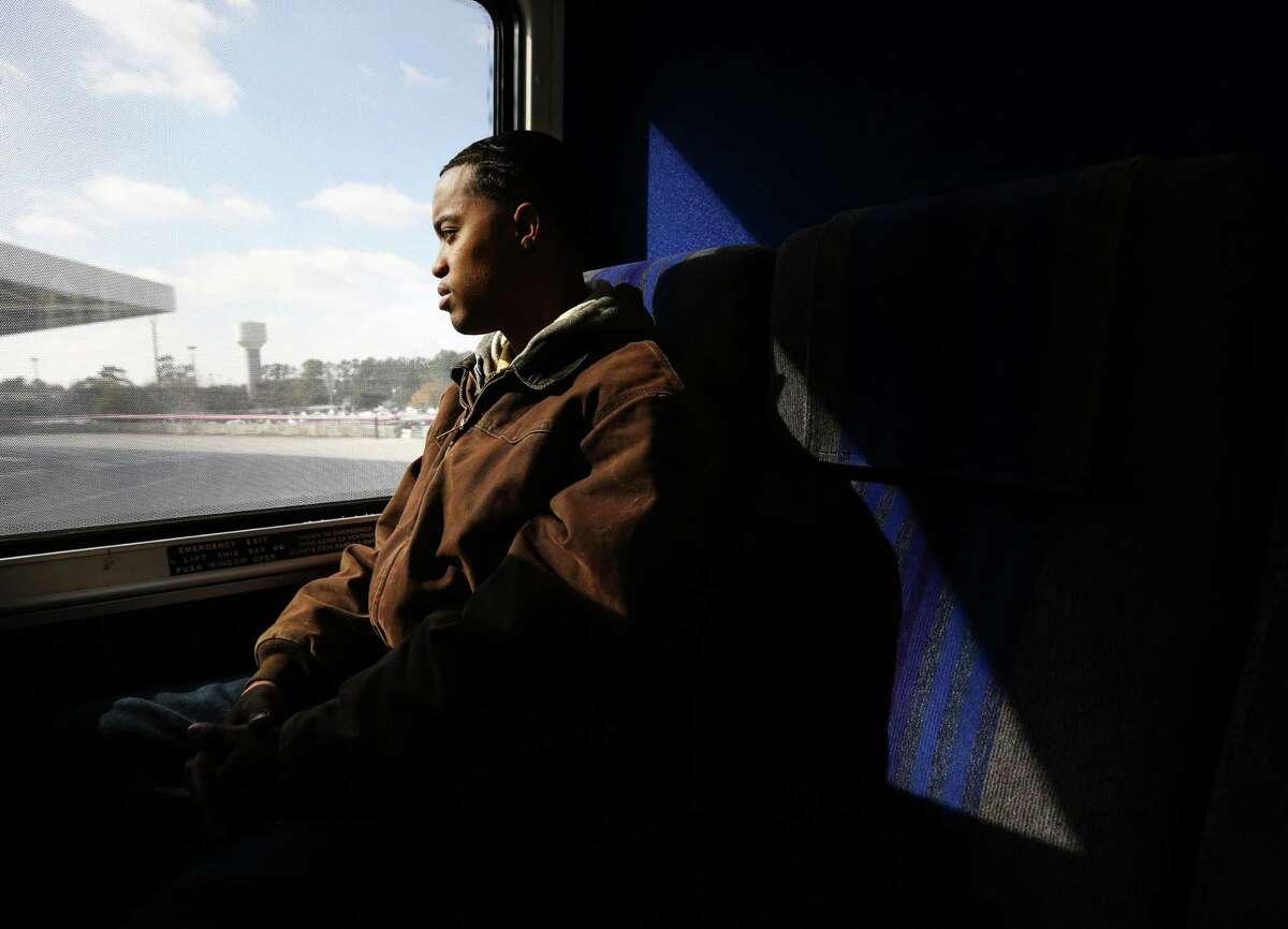 Da'Jon Gradney talks about the kinds of cars he wants to buy as he looks out a bus window Friday, Jan. 22, 2016, in Houston. Gradney was on a two-hour trip home from a monthly meeting with his probation officer. During a period of homelessness after being evicted from a hotel where he and his family lived week-to-week, the Harris County Sheriff's Office Homeless Outreach Team paid for three months in a one-bedroom apartment to help the family get back on their feet. Gradney credits his faith for the help his family has received.