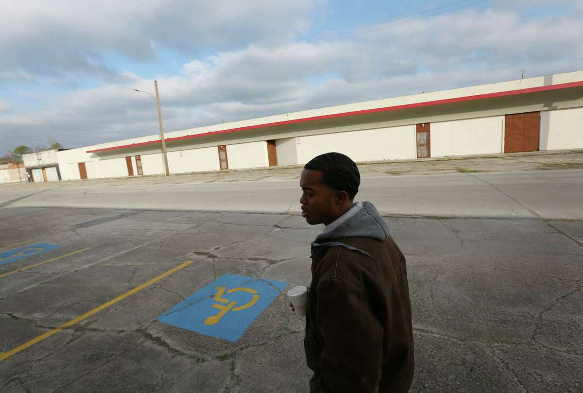 Da'Jon Gradney walks a mile to catch the first of two buses and a train on his way home after his monthly meeting with his probation officer Friday, Jan. 22, 2016, in Houston. Gradney left his apartment before 6 a.m. and rode three buses to make it to the 8 a.m. appointment.