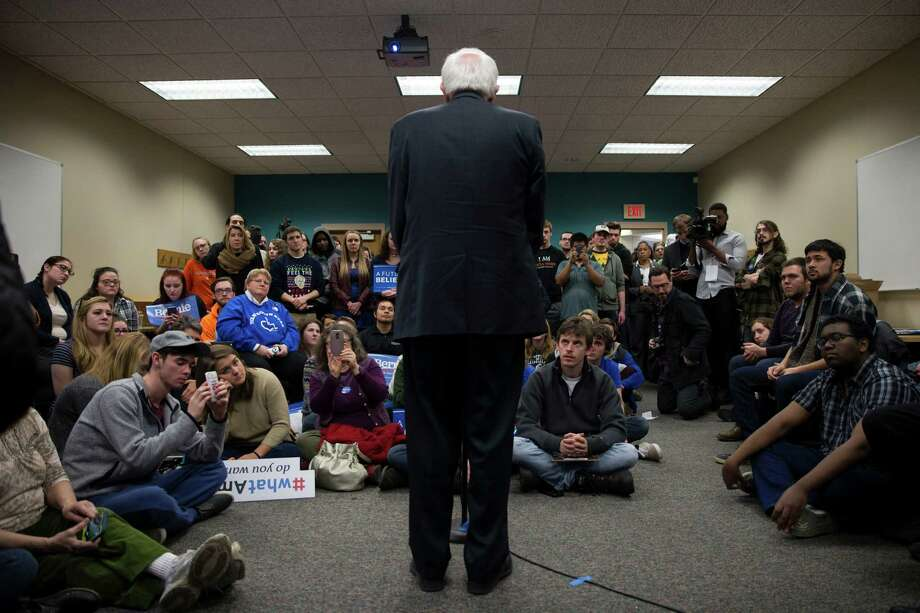 People look on as Democratic presidential candidate Sen. Bernie Sanders, I-Vt., speaks during a meeting with volunteers during a canvass lunch at Wartburg College, on Saturday, Jan. 30, 2016, in Waverly, Iowa. (AP Photo/Evan Vucci) ORG XMIT: IAEV127 Photo: Evan Vucci / AP