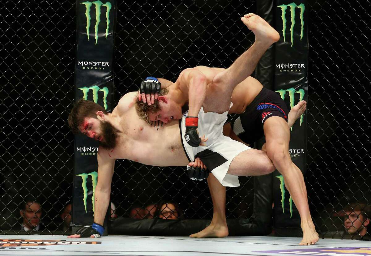 NEWARK, NJ - JANUARY 30: Sage Northcutt of the United State takesdown Bryan Barberena of the United States in the first round of their welterweight bout during the UFC Fight Night event at the Prudential Center on January 30, 2016 in Newark, New Jersey.