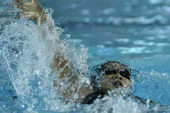 Hannah Feng of Reagan swims to victory in the girls 200-yard intermediate medley during the District 26-6A meet at Davis Natatorium on Jan. 30, 2016.