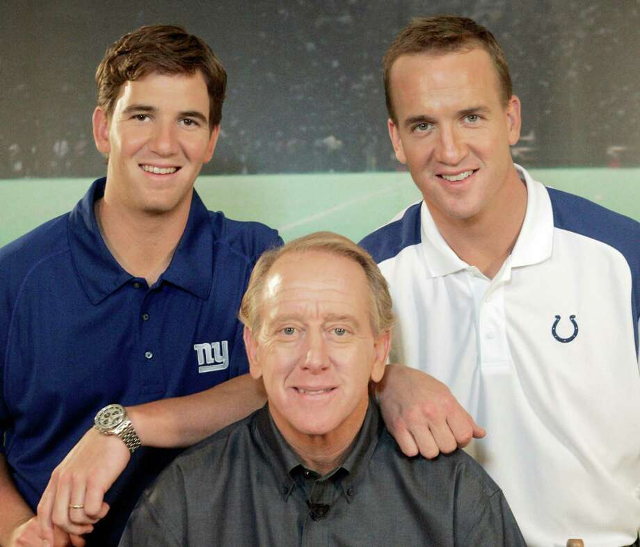 FILE - In this May 8, 2008, file photo, Archie Manning, center, is joined by his sons Eli Manning, left, and Peyton Manning after the taping of a commercial in Beverly Hills, Calif. Archie speaks deliberately and carefully when addressing whether his 39-year-old son, Peyton, might be playing his final NFL game when he returns to the Super Bowl on Feb. 7, 2016. Archie and his other NFL quarterback son, Eli, are clear about one thing, though; they are proud of the way Peyton overcame new challenges in the twilight of his career. (AP Photo/Reed Saxon, File) ORG XMIT: NY111 Photo: Reed Saxon / AP