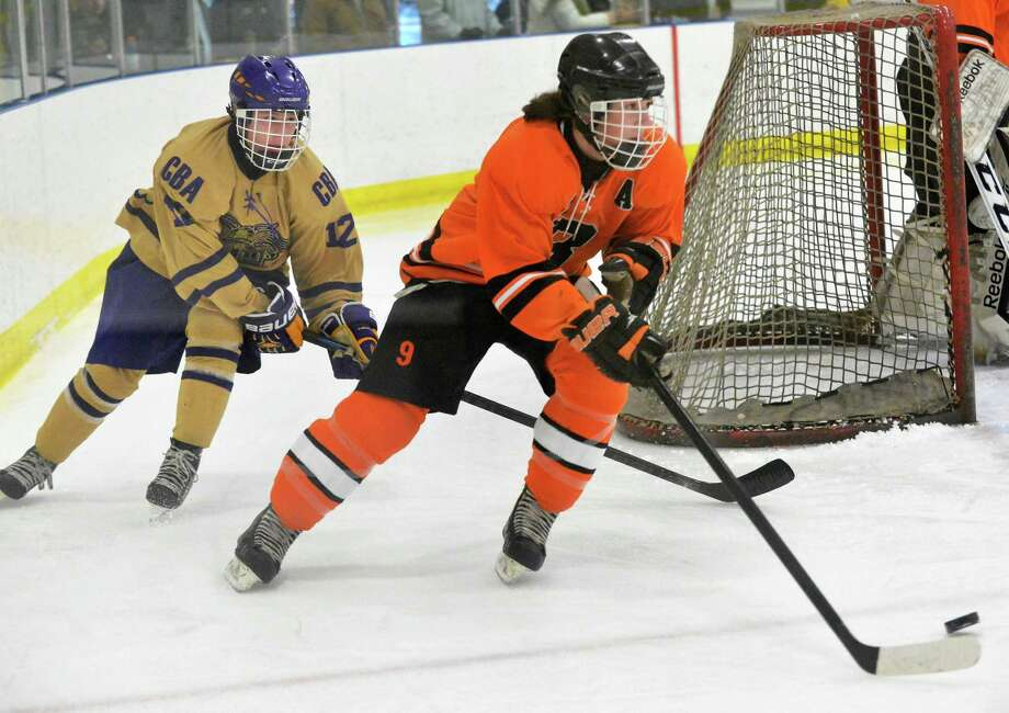 CBA's #12 Alex Boggess, left, chases Bethlehem's #9 Ned Engelbride behind the goal during Saturday's game at the Albany County Ice Rink Jan. 30, 2016 in Colonie, NY.  (John Carl D'Annibale / Times Union) Photo: John Carl D'Annibale / 10035159A