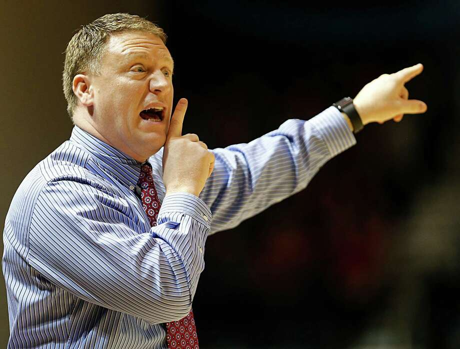 Rice University head basketball coach Mike Rhoades calls  out as Rice's plays the University of St. Thomas during the first half of men's college basketball game at Tudor Fieldhouse Thursday, Dec. 17, 2015, in Houston. Photo: James Nielsen, Houston Chronicle / © 2015  Houston Chronicle