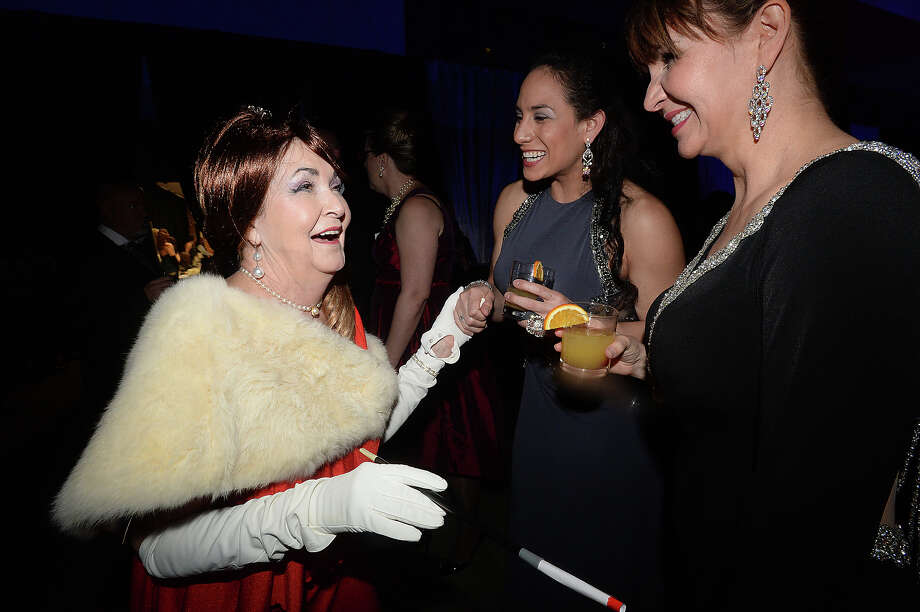 From left, Ann Jones, Xochitl Garza, and Michele Harrington joke with one another as they get in the spirit of the evening at La Soiree, Baptist Hospital's annual fundraising gala. Guests donned their best apparel in the style of this year's Mad Men theme, enjoying music, drink and dining, as well as a silent auction and the grand decor that transforms the Civic Center at each event.  Photo taken Saturday, January 30, 2016  Kim Brent/The Enterprise Photo: Kim Brent / Beaumont Enterprise