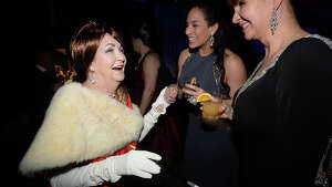From left, Ann Jones, Xochitl Garza, and Michele Harrington joke with one another as they get in the spirit of the evening at La Soiree, Baptist Hospital's annual fundraising gala. Guests donned their best apparel in the style of this year's Mad Men theme, enjoying music, drink and dining, as well as a silent auction and the grand decor that transforms the Civic Center at each event.  Photo taken Saturday, January 30, 2016  Kim Brent/The Enterprise