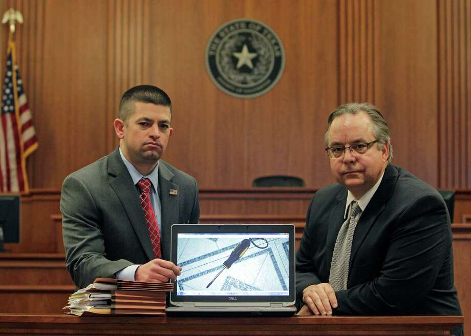 Galveston County District Attorney Jack Roady, right, and Matthew Shawhan, an assistant district attorney for the county, show an image of a screwdriver believed to have been used by German Perez-Vasquez in a homicide. DNA analysis on the screwdriver initially showed there was a 1 in 290 million chance that a different person of a similar ethnic background to the defendant had touched it. The new protocol, released back in January 2010 but implemented unevenly across the country, found a 1 in 38 chance. Photo: Steve Gonzales / © 2016 Houston Chronicle