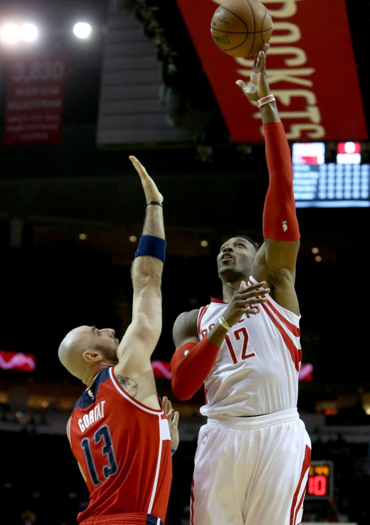 Houston Rockets guard Patrick Beverley (2) scores a basket guarded by Washington Wizards center Marcin Gortat (13) during the first quarter at the Toyota Center Saturday, Jan. 30, 2016, in Houston, Texas. ( Gary Coronado / Houston Chronicle )