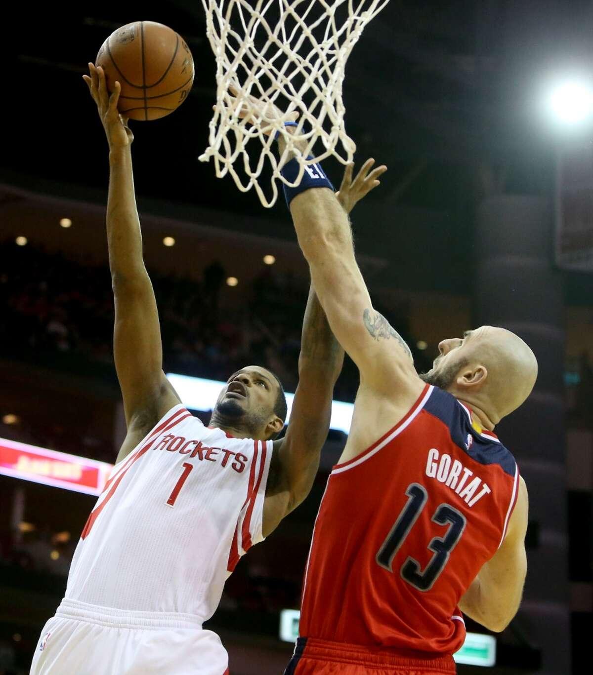 Houston Rockets forward Trevor Ariza (1) drives to the basket guarded by Washington Wizards center Marcin Gortat (13) during the first quarter at the Toyota Center Saturday, Jan. 30, 2016, in Houston, Texas. ( Gary Coronado / Houston Chronicle )