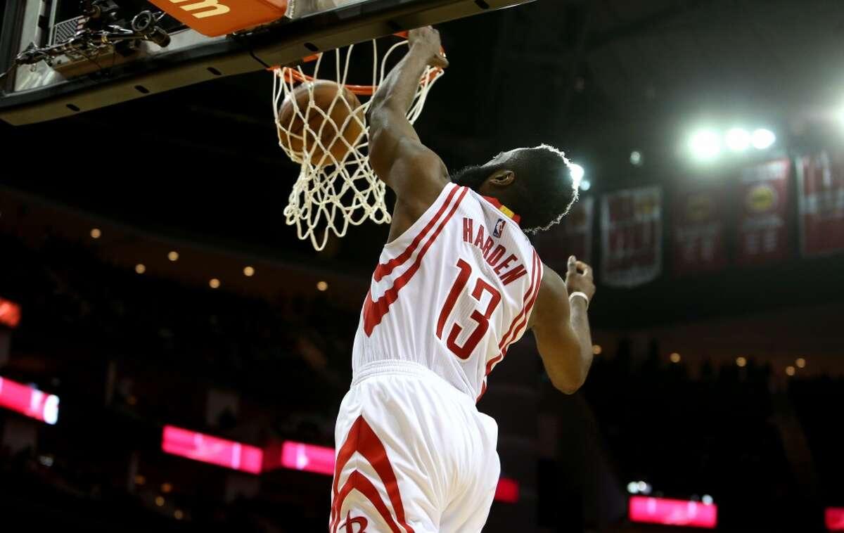 Houston Rockets guard James Harden (13) slam dunks the ball agains the Washington Wizards during the first quarter at the Toyota Center Saturday, Jan. 30, 2016, in Houston, Texas. ( Gary Coronado / Houston Chronicle )