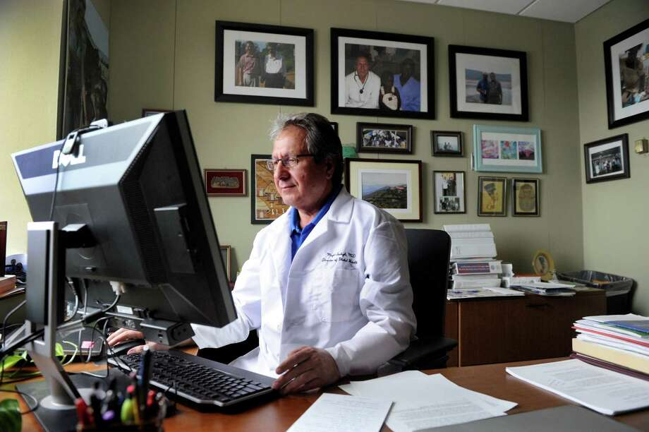 Dr. Majid Sadigh, photographed in his office at Danbury Hospital, is director of Global health for Western Connecticut Health Network, Monday, March 30, 2015. He is running a clinical trial for a vaccine to prevent infections from Clostridium difficile, a germ that sickens thousands of people in the U.S. His site is one of 200 nationwide, but only two in Connecticut. The other is in Bristol. Photo: Carol Kaliff / Hearst Connecticut Media / The News-Times