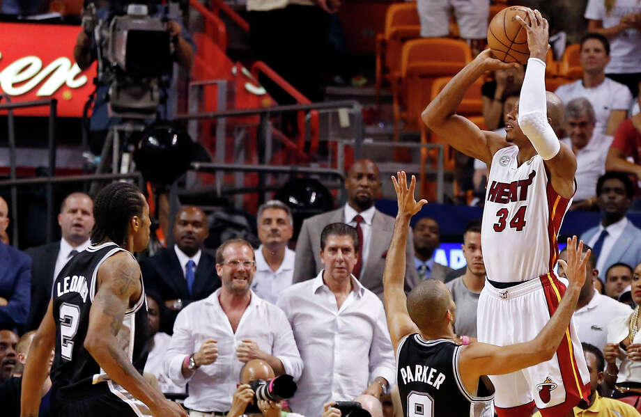 Heat's Ray Allen shoots a 3-pointer to tie the game late in the fourth quarter over Spurs' Tony Parker as Kawhi Leonard looks on in Game 6 of the 2013 NBA Finals on June 18, 2013 at AmericanAirlines Arena in Miami. Photo: Edward A. Ornelas /San Antonio Express-News / © 2013 San Antonio Express-News