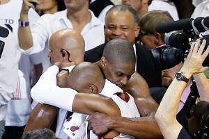 Chris Bosh (right) and Ray Allen hug after the Heat defeated the San Antonio Spurs 103-100 in overtime in Game 6 of the 2013 NBA Finals at AmericanAirlines Arena on June 18, 2013 in Miami.