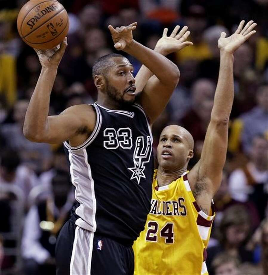 San Antonio Spurs' Boris Diaw (33) passes in front of Cleveland Cavaliers' Richard Jefferson (24) during the first half of an NBA basketball game Saturday, Jan. 30, 2016, in Cleveland. (AP Photo/Tony Dejak) Photo: Tony Dejak, Associated Press