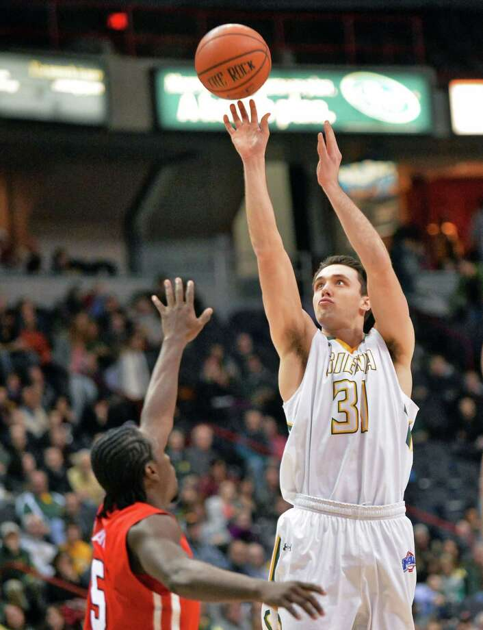 Siena's #3 Brett Bisping, left, sinks a three pointer during Saturday's game against Marist at the Times Union Center Jan. 30, 2016 in Albany, NY.  (John Carl D'Annibale / Times Union) Photo: John Carl D'Annibale / 10034935A