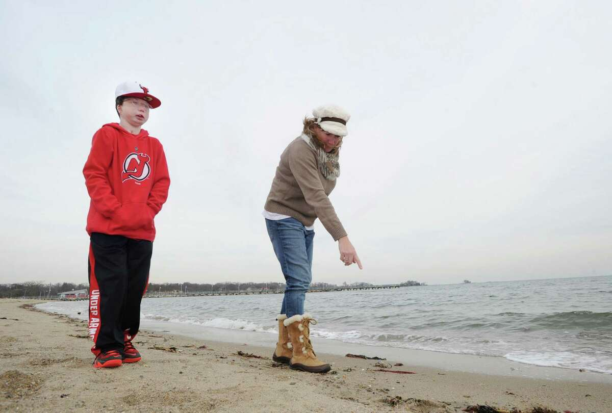 Betsy O'Reilly and her 17-year-old son, Kyle O'Reilly, look for sea glass along the West Beach shoreline in Stamford, Conn., Friday afternoon, Jan. 15, 2016. The sea glass collecting activity is a pastime the Stamford mother and son have shared since Kyle was little. Kyle was born with a rare genetic condition called Nablus syndrome. To date, he's had more than 20 surgeries and other procedures related to his condition. Kyle is a big New York Yankees fan and said his favorite all-time Yankee is Derek Jeter, who he said he has met.