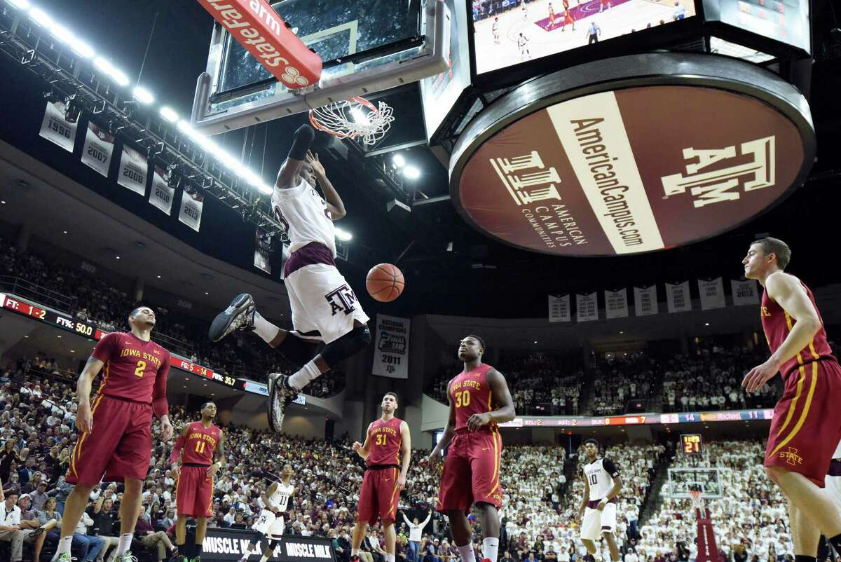 Texas A&M's Danuel House (23) dunks against Iowa State during the first half of an NCAA college basketball game, Saturday, Jan. 30, 2016, in College Station, Texas.