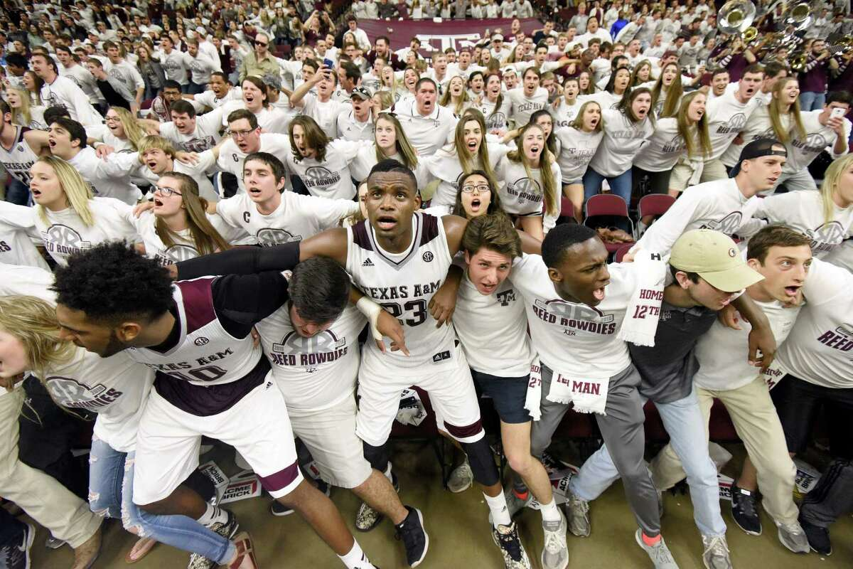 Texas A&M's Danuel House (23) sings the Aggie War Hymn with students at Reed Arena after a 72-62 win over Iowa State in an NCAA college basketball game, Saturday, Jan. 30, 2016, in College Station, Texas. (AP Photo/Sam Craft)