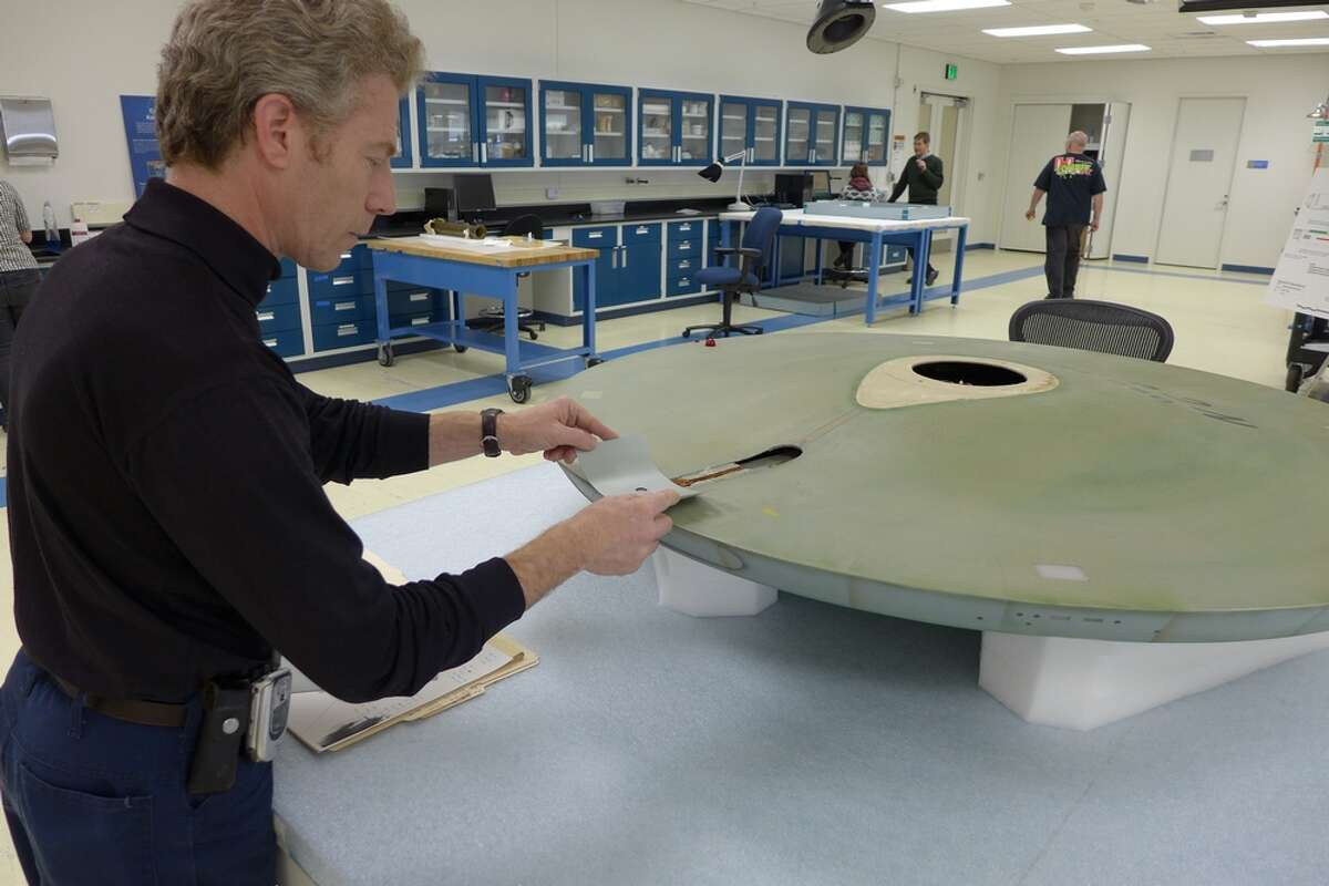 Museum Specialist David Wilson finds the exact color match to the pilot episode grey paint hidden inside the saucer.