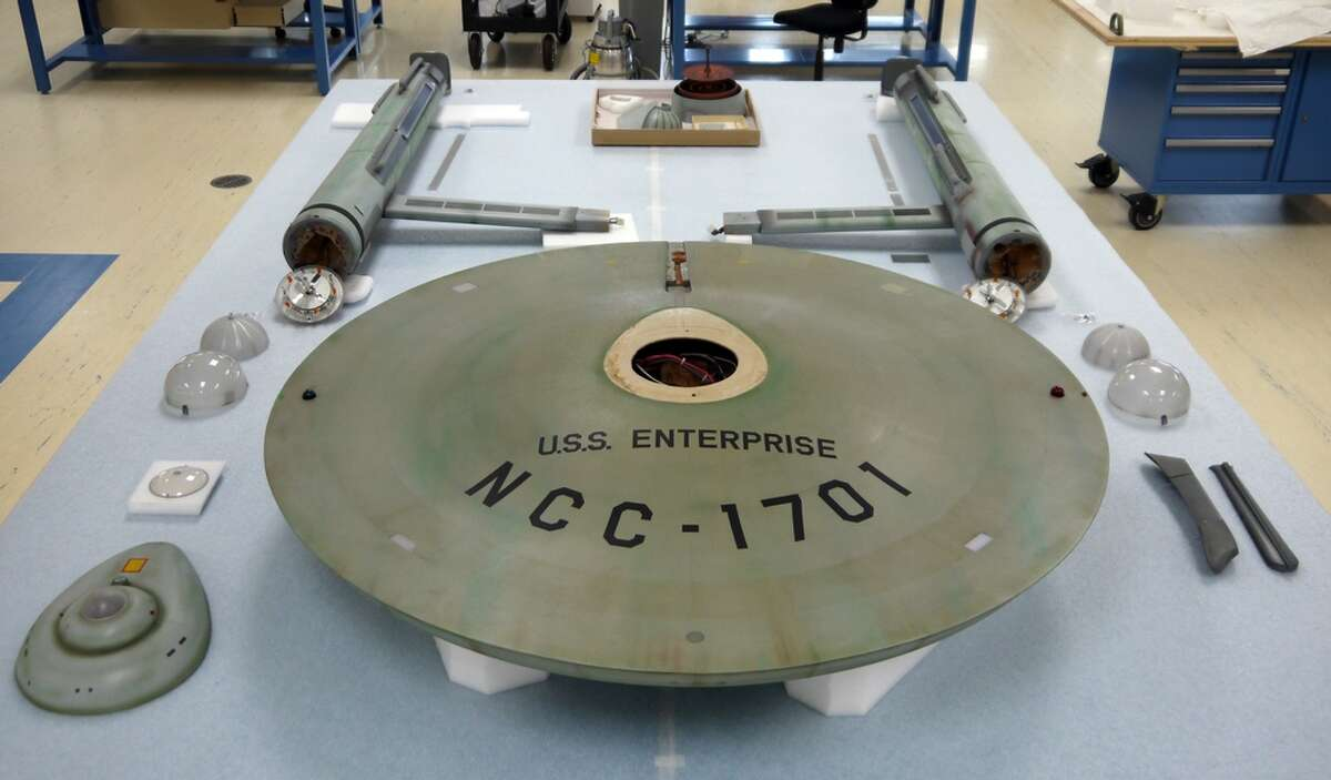 The Star Trek starship Enterprise model separated into its component parts.