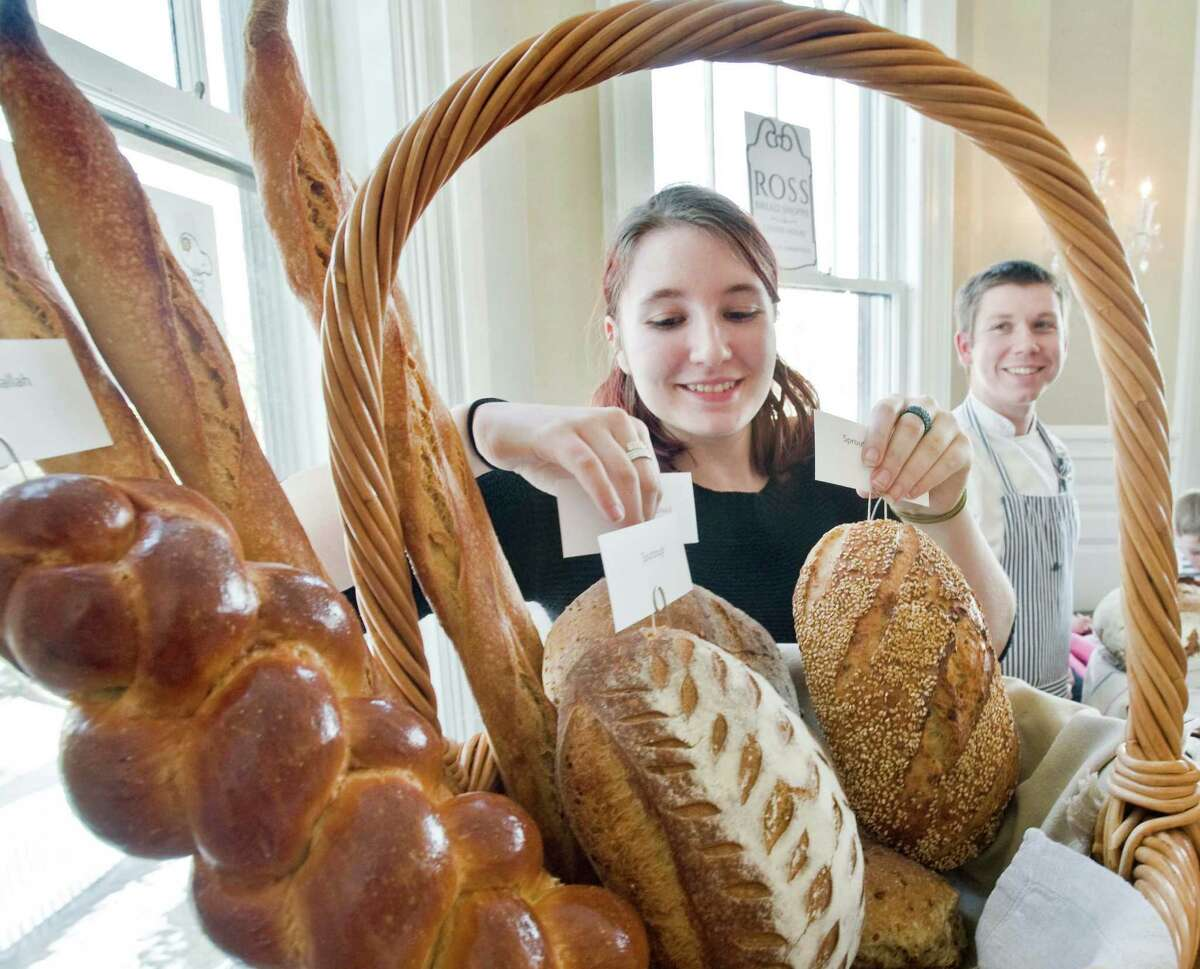 Annie Tritchonis and James Alworth of Ross Bread Shoppe & Coffee House with a display of baked goods at A Taste of Ridgefield in the Lounsbury House featuring local restaurants, hosted by the Ridgefield Rotary Club. Sunday, Jan. 31, 2016