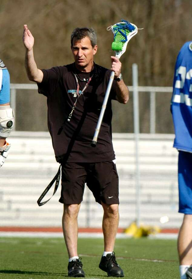 Coach Jeff Brameier talks to team during boys lacrosse practice at Darien High School in Darien, Conn. on Monday April 5, 2010. Photo: Dru Nadler, ST / Stamford Advocate