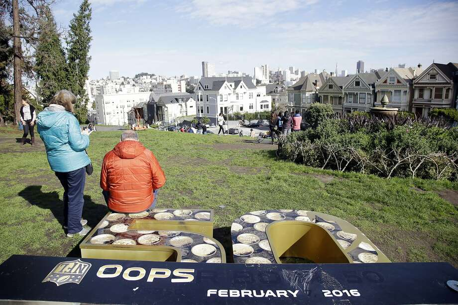 A vandalized Super Bowl sign lies on the ground at Alamo Square Saturday, Jan. 30, 2016, in San Francisco. San Francisco is hosting various festivities in conjunction with the Super Bowl which will be played on Sunday, Sept. 7th, in Santa Clara, Calif. Photo: Marcio Jose Sanchez, Associated Press