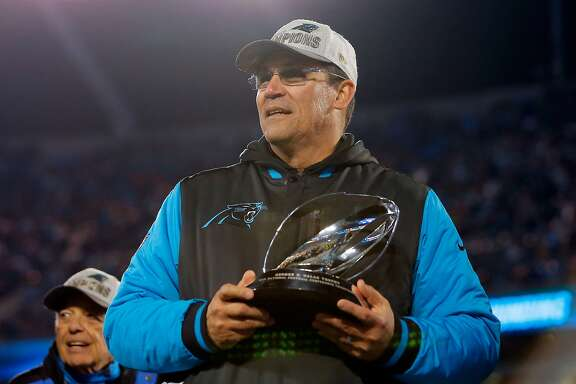 CHARLOTTE, NC - JANUARY 24:  Head coach Ron Rivera of the Carolina Panthers celebrates with the George Halas Trophy after defeating the Arizona Cardinals with a score of 49 to 15 to win the NFC Championship Game at Bank of America Stadium on January 24, 2016 in Charlotte, North Carolina.